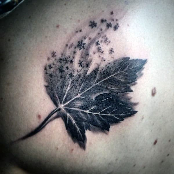Leaf With Snowflakes Guys Back Tattoo