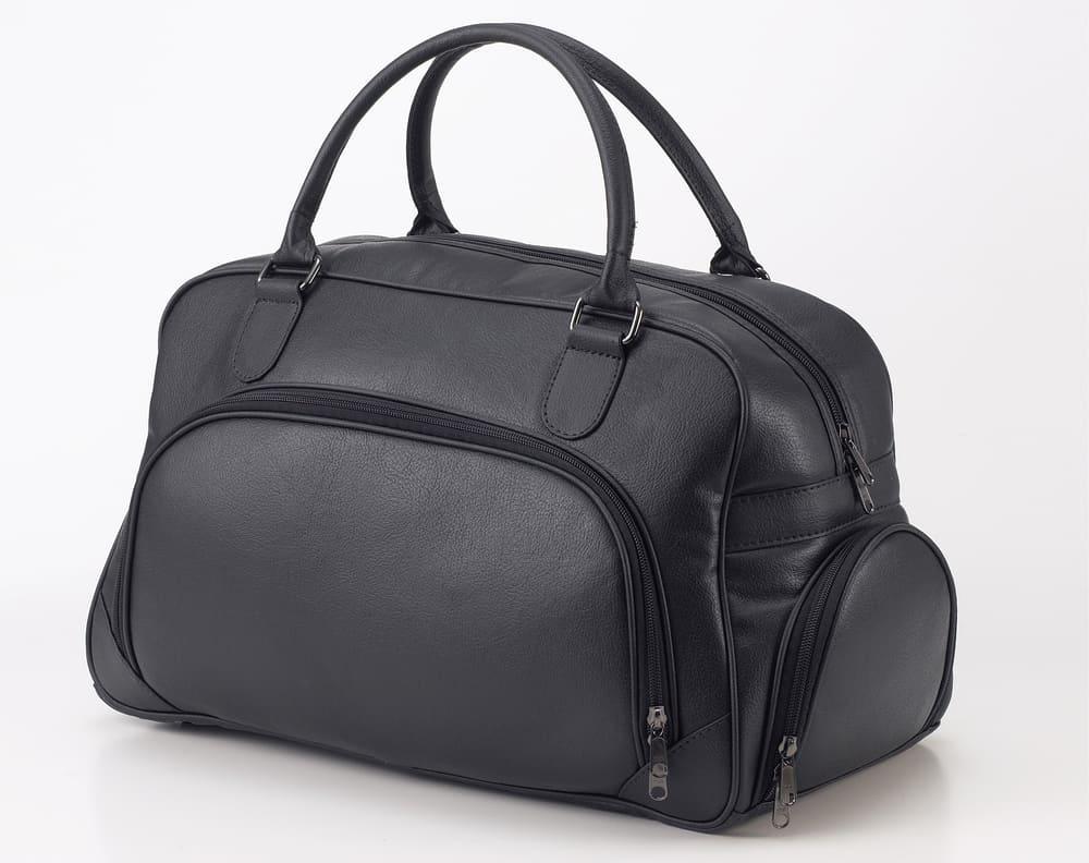 black leather travel bag isolated on white background