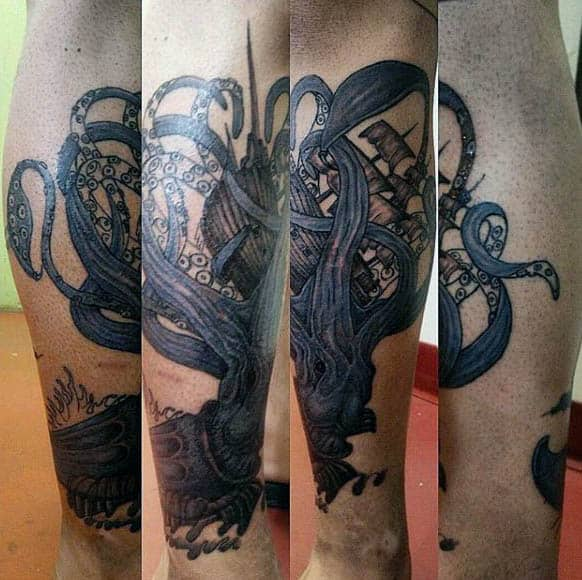 Leg Calf Blue Squid Swallowing Sailboat Tattoo On Man