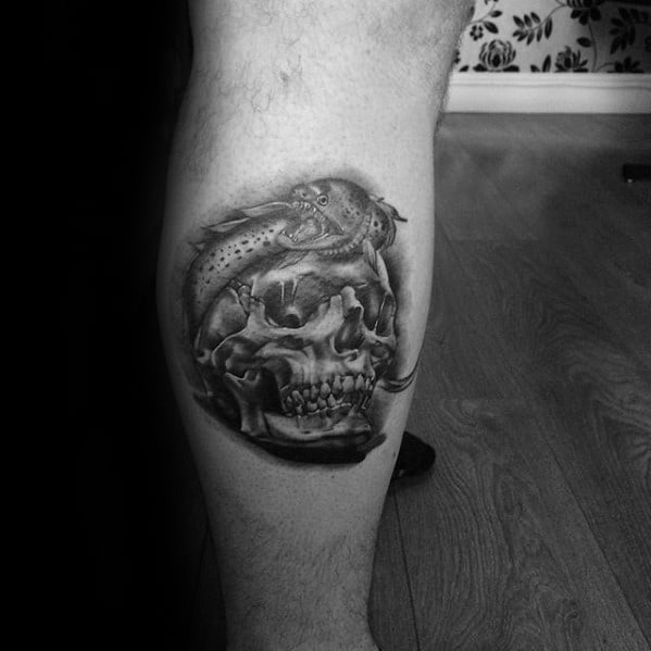 Leg Calf Male Tattoo With Eel Wrapped Around Skull Design