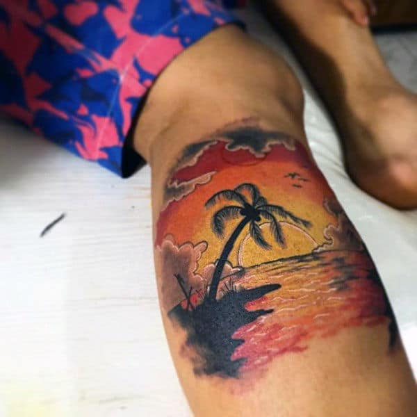 Leg Calf Mens Beach Sunset Tattoo In Orange Ink
