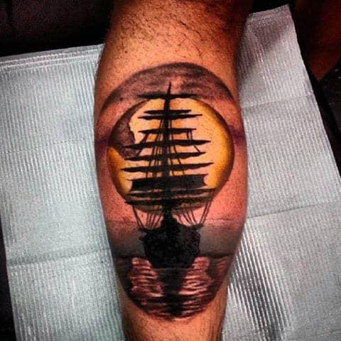 Leg Calf Sailboat Sunset At Sea Tattoo For Guys