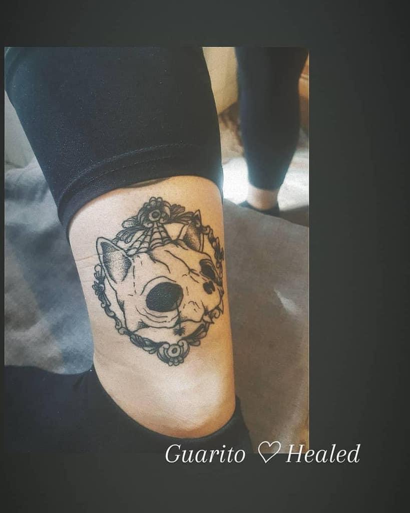 leg cat skull tattoo calypso.tattoo