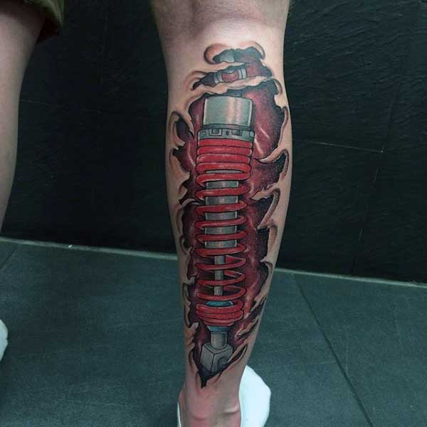 Leg Mechanical Shock Skin Ripping Open Tattoo On Man