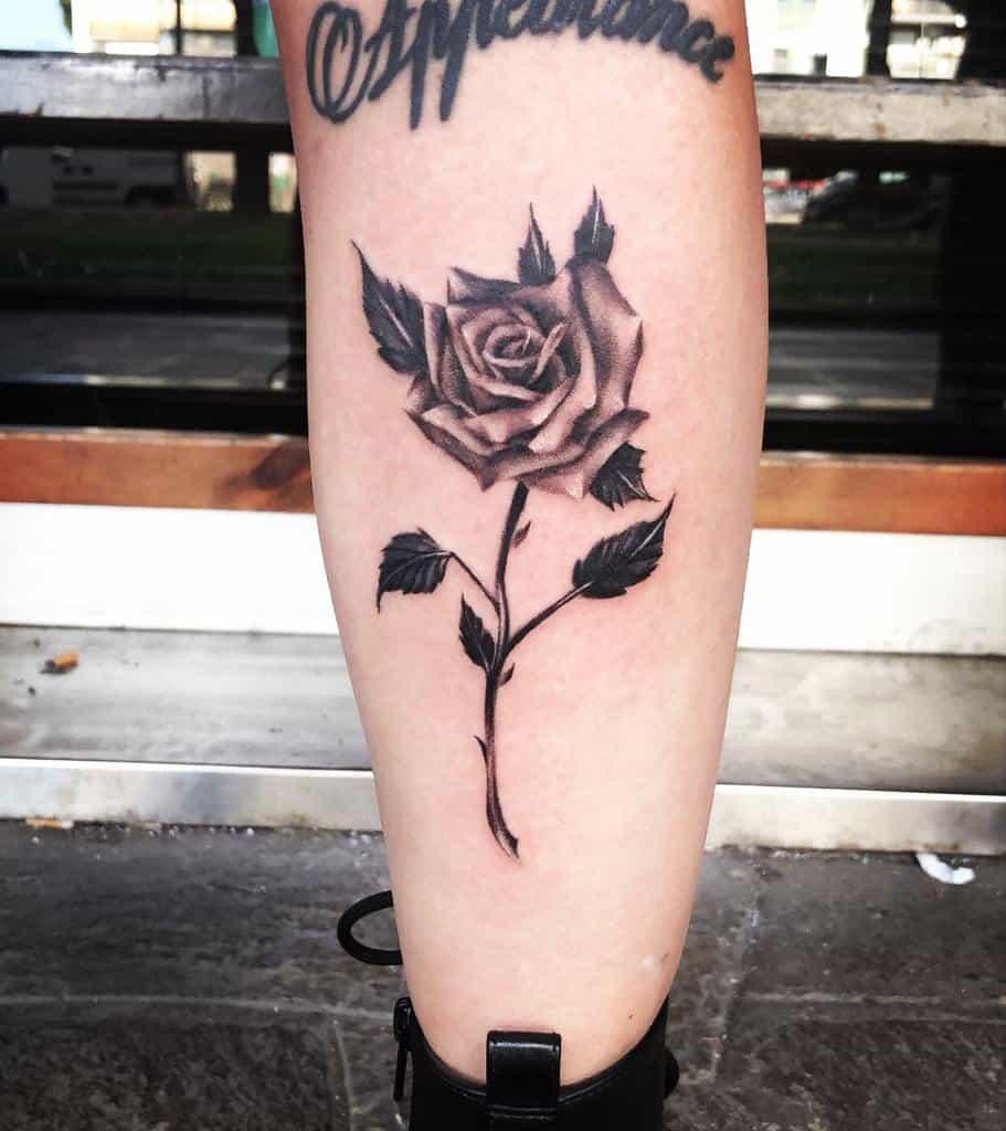 leg rose with stem tattoos empire_tattoo_roma