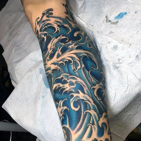 leg-sleeve-blue-ink-japanese-wave-guys-tattoo-ideas