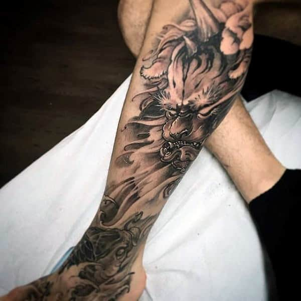 Leg Sleeve Koi Fish Tattoo On Man