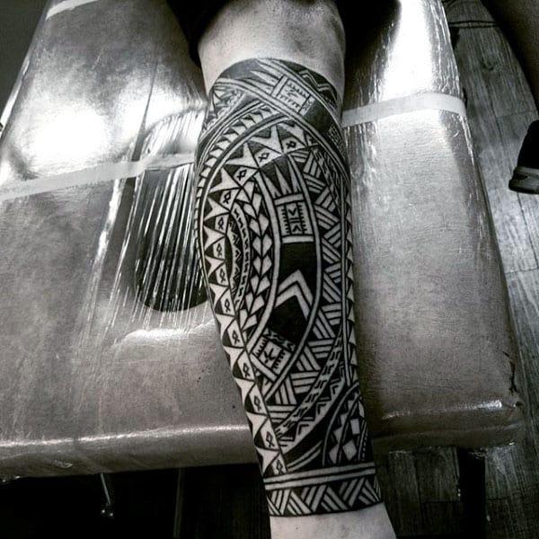 Leg Sleeve Tattoo On Male Of Tribal Design