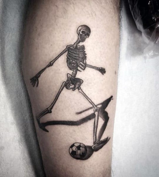 Leg Tattoo Of Skeleton Man Kicking Soccerball Guys Arm Tattoos