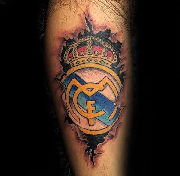 Leg Torn Skin Gentleman With Real Madrid Tattoo