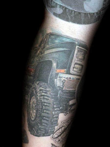 Lifted Truck With Big Tires Mens Leg Tattoos