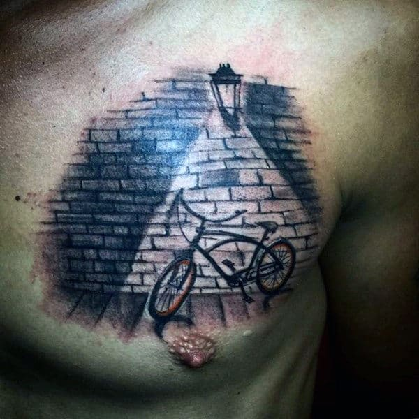 Light Focused Bicycle Tattoo On Chest Male