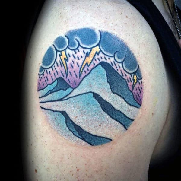 Lighting Thunder With Mountains Mens Circle Tattoo On Upper Arm