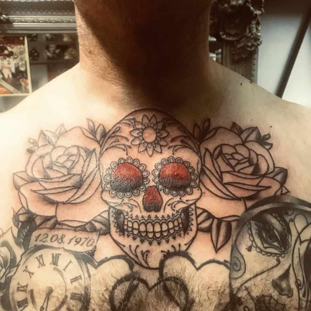 line-work-traditional-skull-rose-chest-tattoo-ghostinktattoostudio