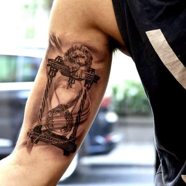 Lion And Hourglass Mens Bicep Tattoo Design Inspiration