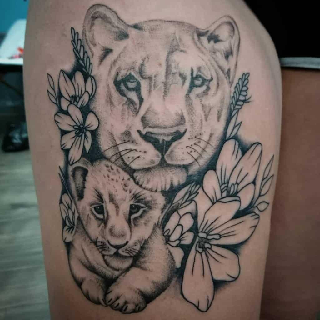 Lion Cub Flower Dynamic Ink Tattoo