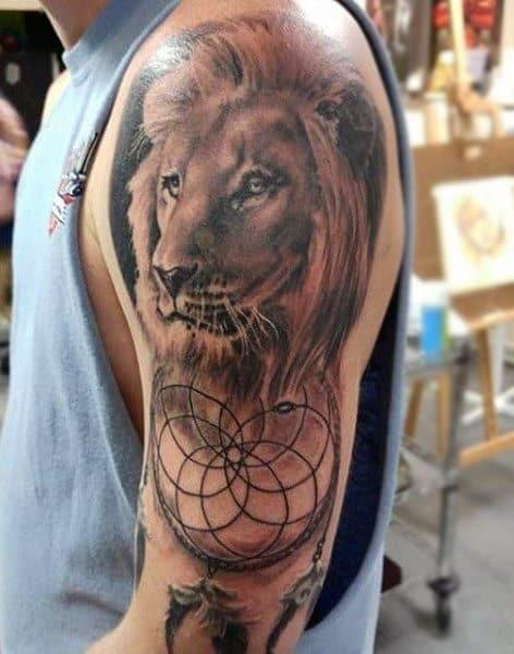 Lion Dreamcatcher Tattoo On Mans Arm