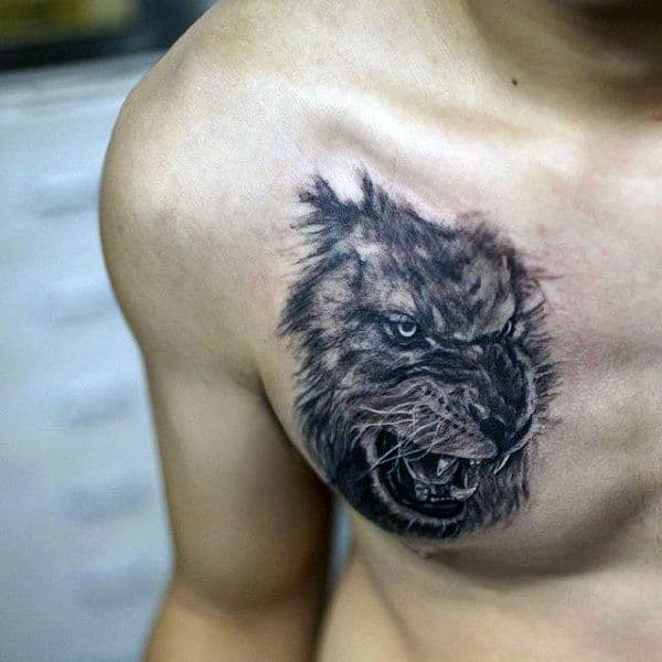Lion Face Tattoo For Men On Chest