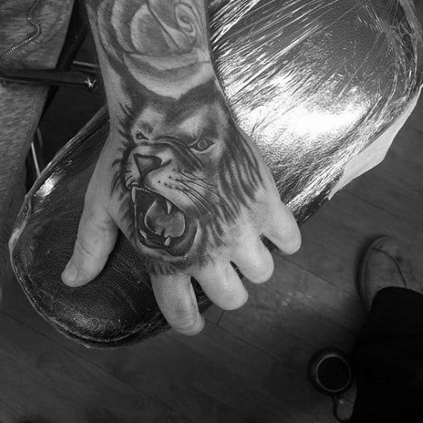 Lion Roaring Hand Tattoos For Males