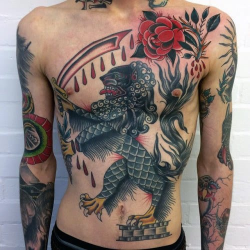 Lion Traditional Guys Chest Tattoo Design Ideas