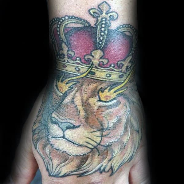 Lion With Crown Guys Tattoo On Hand