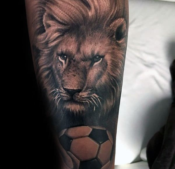Lion With Soccerball Mens Forearm Sleeve Tattoo Design Inspiration