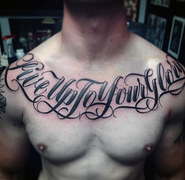 Live Upto Your Glory Lettering Tattoo Male Chest