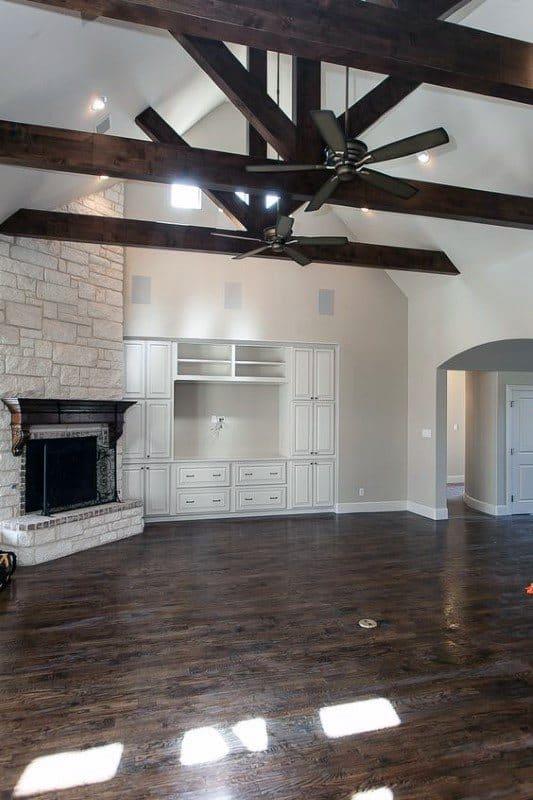 Living Room Stone Corner Fireplace Design