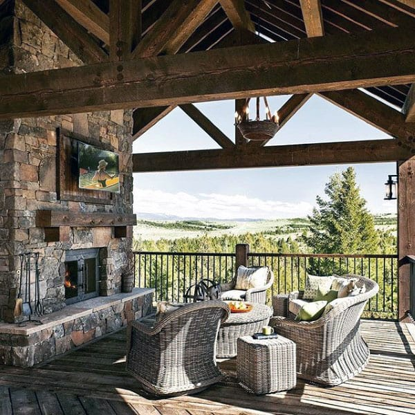 Log Cabin Rustic Outdoor Fireplace With Wood Ceiling Beams