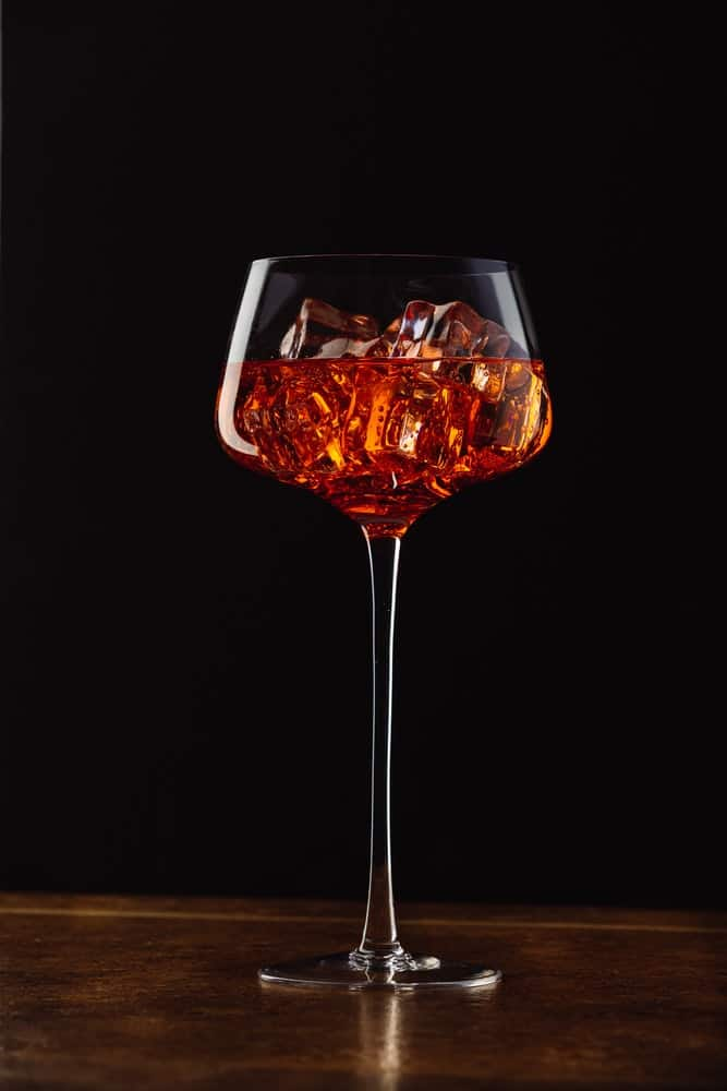 long stand glass filled with wine and ice