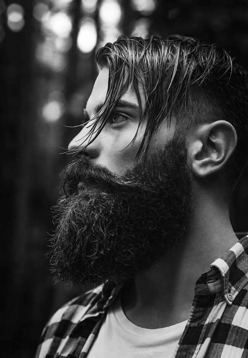 Long Undercut Hairstyle On Man With Thick Beard