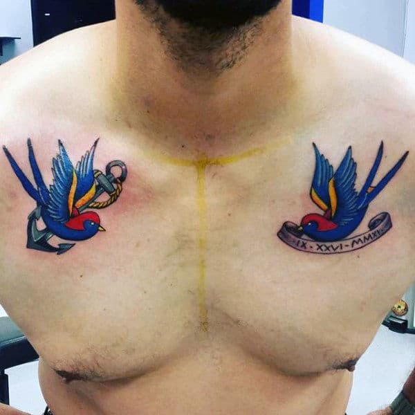Lovely Pair Of Navy Blue Sparrows Tattoo Guys Chest