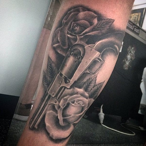 Lovely Rose And Pistol Tattoo On Lower Legs For Guys