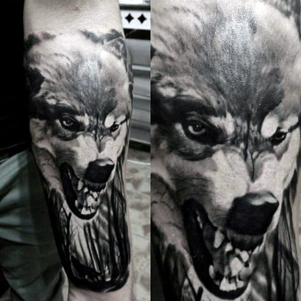 Lower Forearm Mens Growing Wolf Animal Tattoo