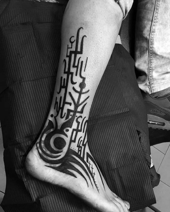 Lower Leg And Ankle Tribal Blast Over Tattoo Ideas For Males