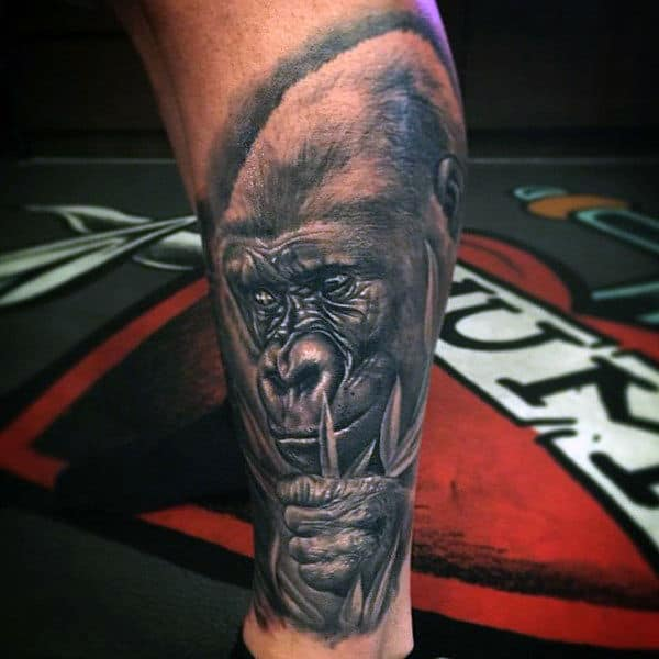 Lower Leg Gorilla Holding A Leaf Branch Tattoo For Men