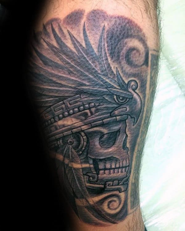 Lower Leg Tattoo Of Mayan Skull On Guy