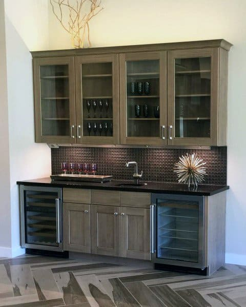 Luxury Metal Backsplash With Wood Cabinets And Hardwood Floors