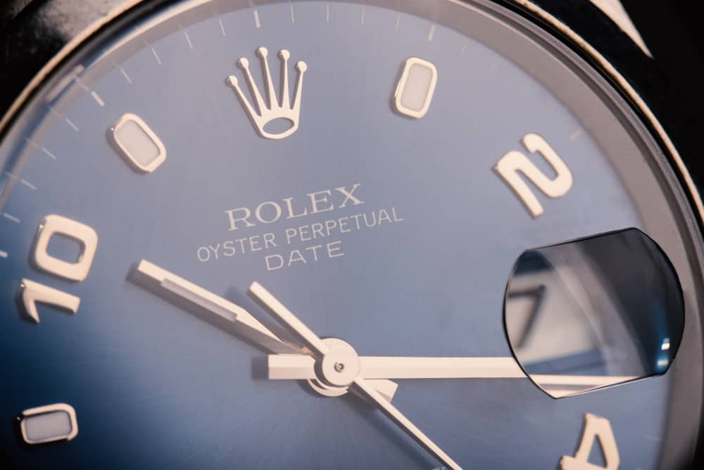 rolex oyster perpetual date watch magnification of date close up