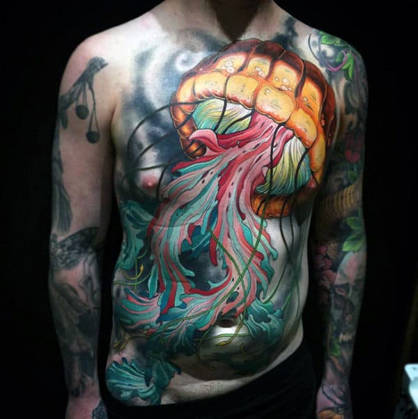 Magnificient Lighted Jellyfish With Colored Squiggles Tattoo Male Torso