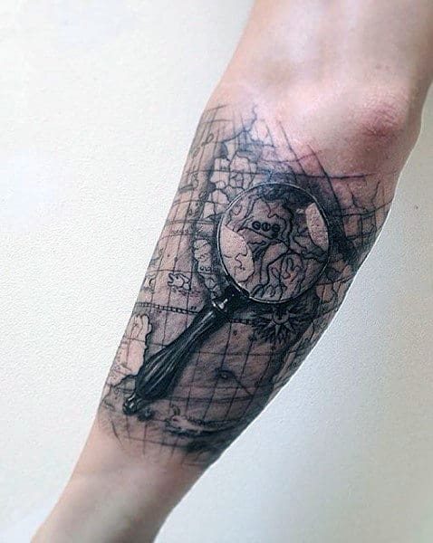 50 world map tattoo designs for men adventure the globe magnifying glass world map outer forearm mens tattoo gumiabroncs Images