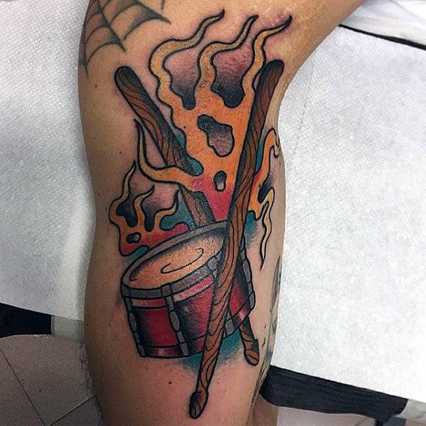 Male Arm Tattoo Of Drums With Sticks And Flames
