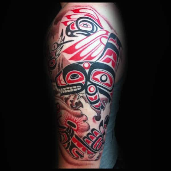 Male Arms Red And Black Haida Tattoo