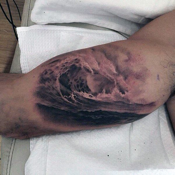 Male Arms Roaring Sick Waves Tattoo