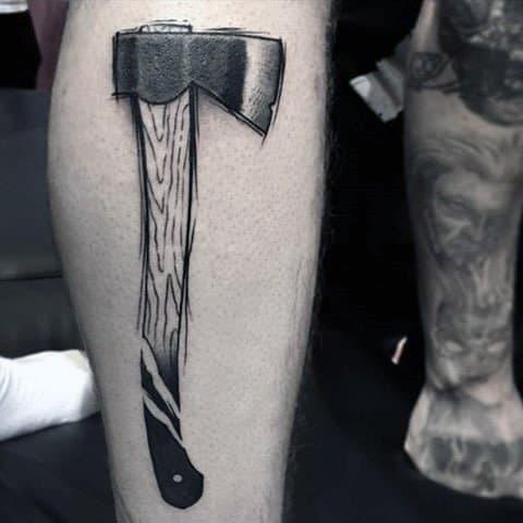 Male Axe Tattoo On Leg