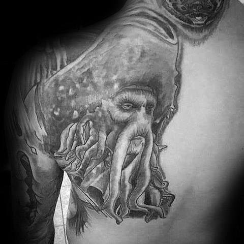 Male Back Shoulder Blade Tattoo With Davy Jones Design