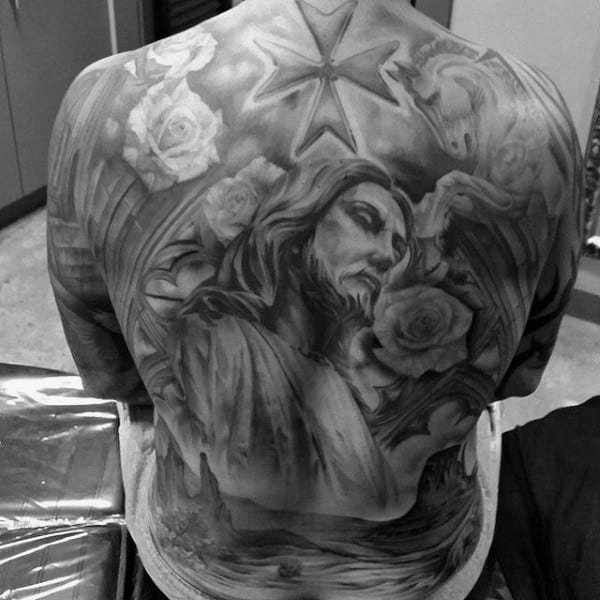 Male Back Tattoo Of Jesus Christ With Shaded Black And Grey Ink