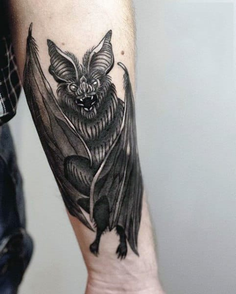 Male Bat Tribal Tattoo On Wrist