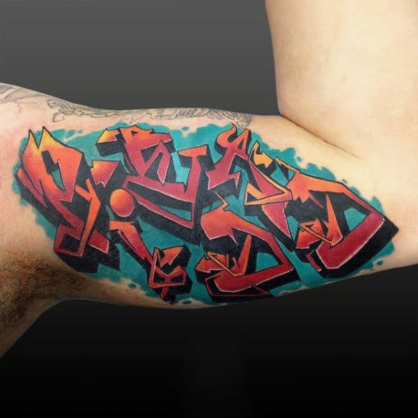 Male Bicep Graffiti Orange Symbol Tattoo