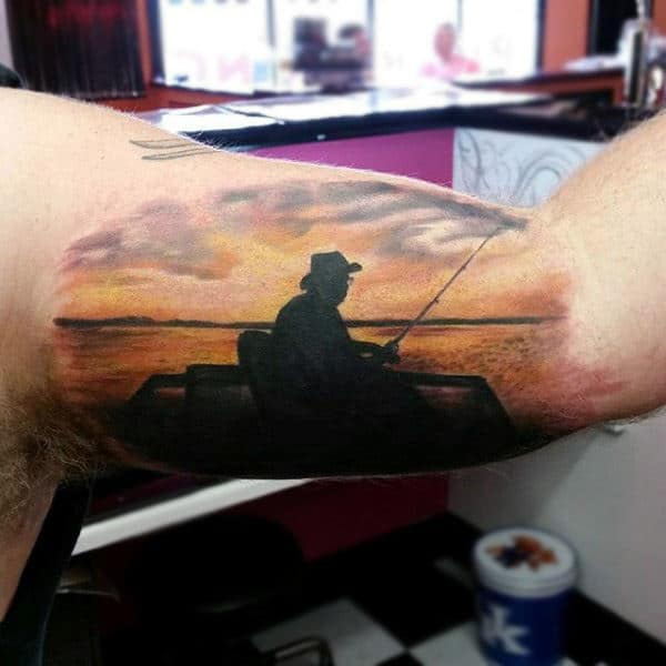 Male Bicep Tattoo Man Fishing On Lake At Sunset